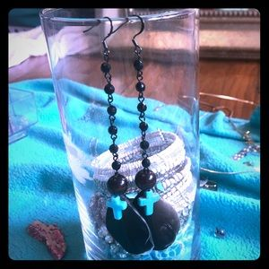 Handmade earrings with duck feathers